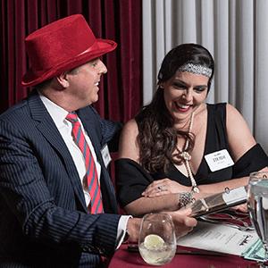 Cincinnati Murder Mystery couple checking out the dinner menu